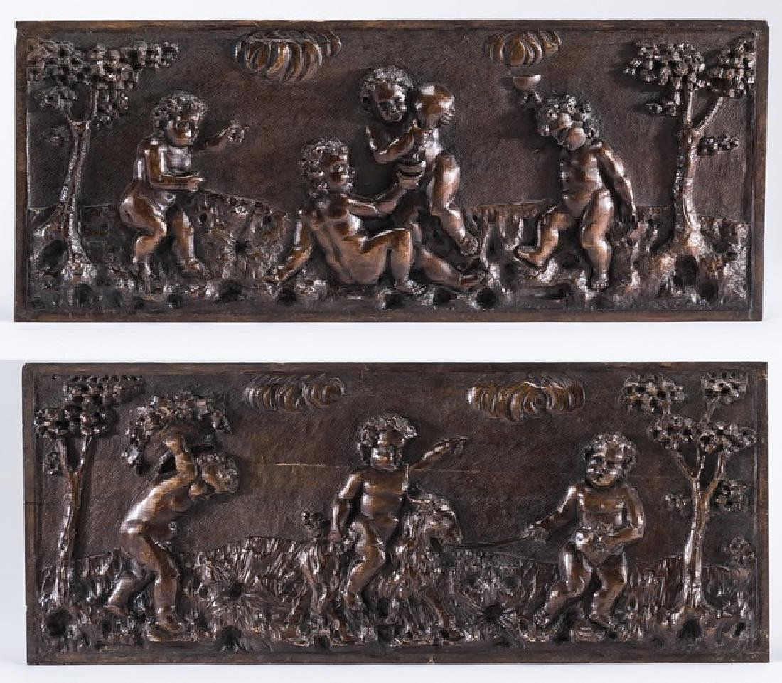 (2) 19th c. relief carved walnut panels w/putti