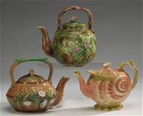 "Group of three majolica teapots, 8""h"