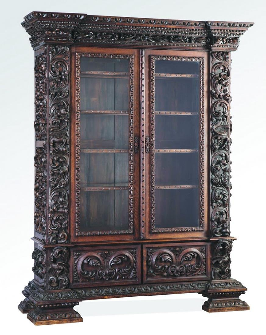 19th c. Italian oak bookcase carved in high relief