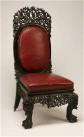"""19th c. Burmese carved chair in leather, 54""""h"""