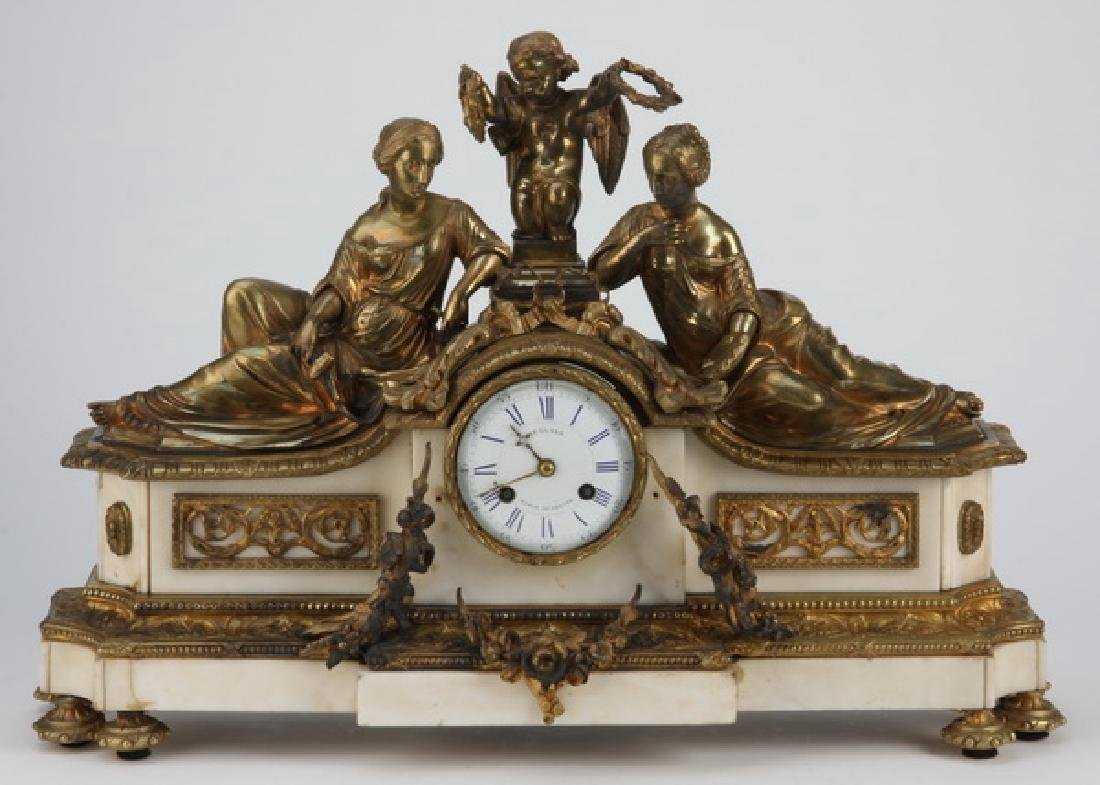 """19th c. French figural bronze and marble clock, 24""""w"""