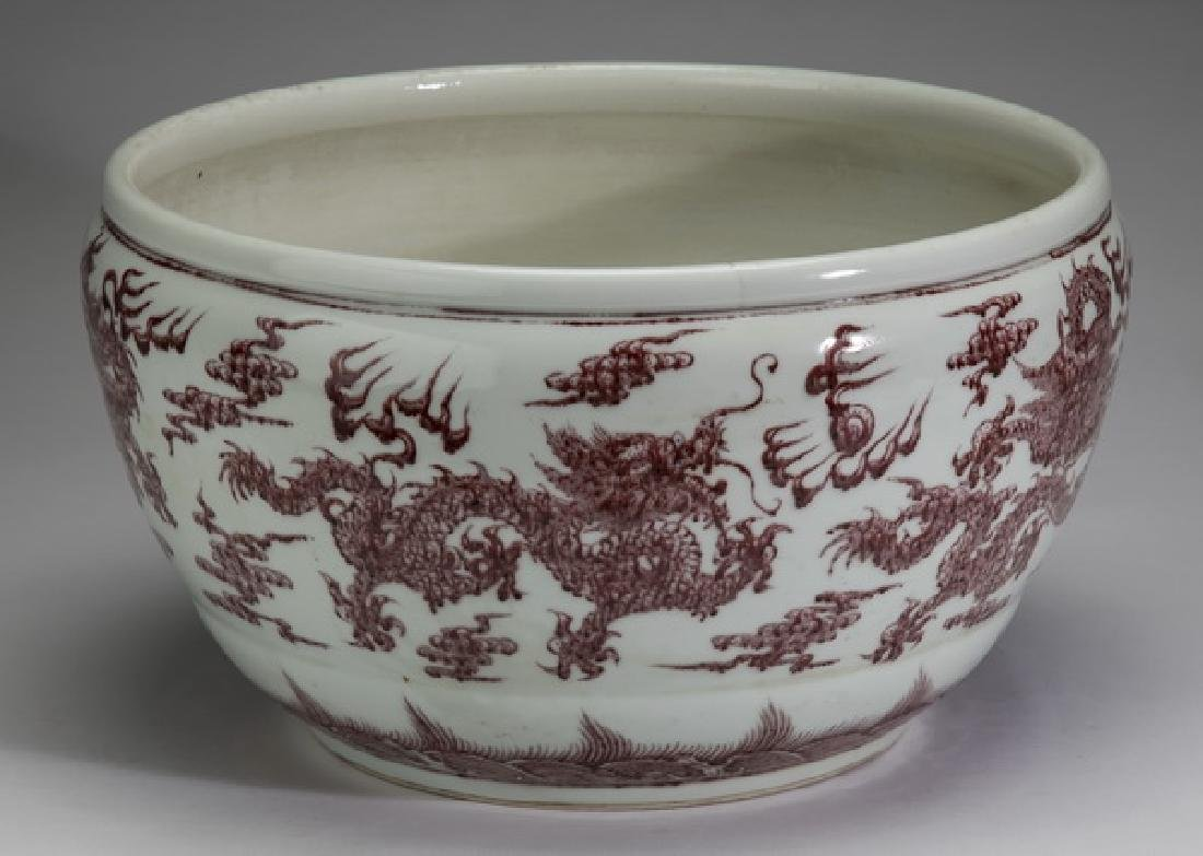 "Chinese iron red dragon basin, Qianlong mark, 15""w."