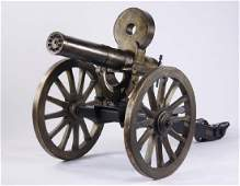 "Full-size bronze replica Gatling gun, 105"" long"