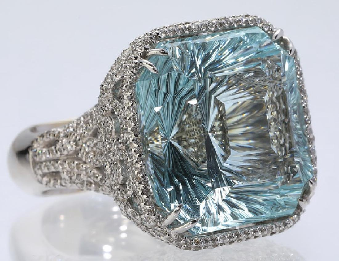 Fancy cut 51cts aquamarine, diamond & 18k ring