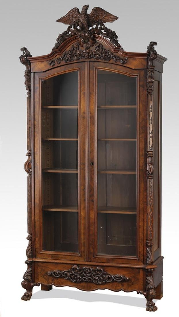 Late 19th c. burl walnut vitrine with eagle crest