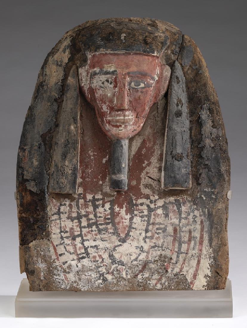 Ancient Egyptian carved wood mummy mask