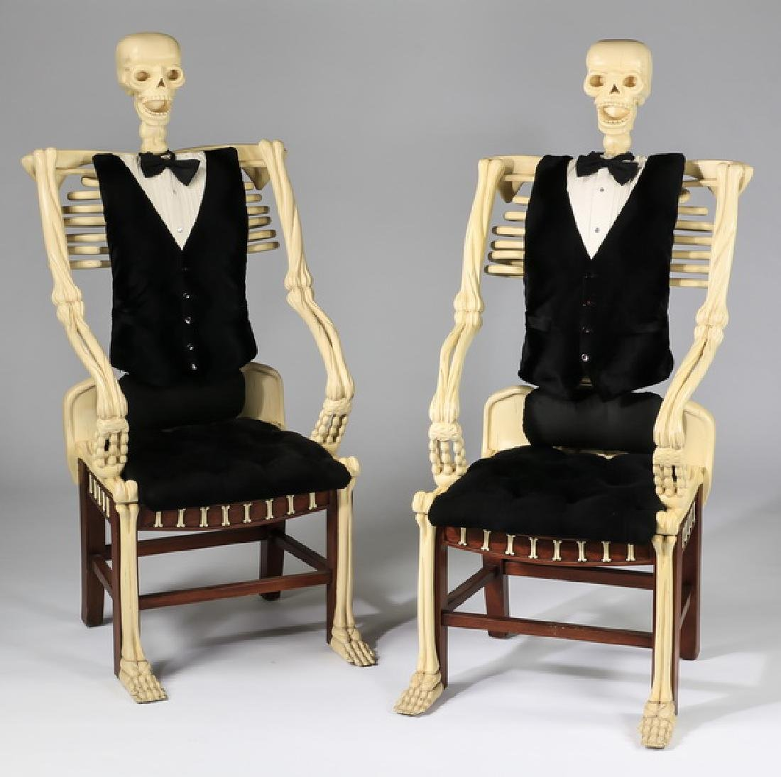 """(2) Carved mahogany skeleton-form armchairs, 54""""h"""