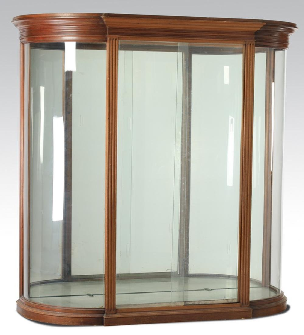 "19th c. French Empire style serpentine vitrine, 69""w"