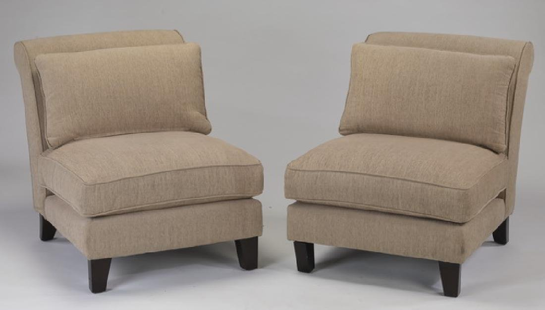 Pair of contemporary scroll-back upholstered chairs