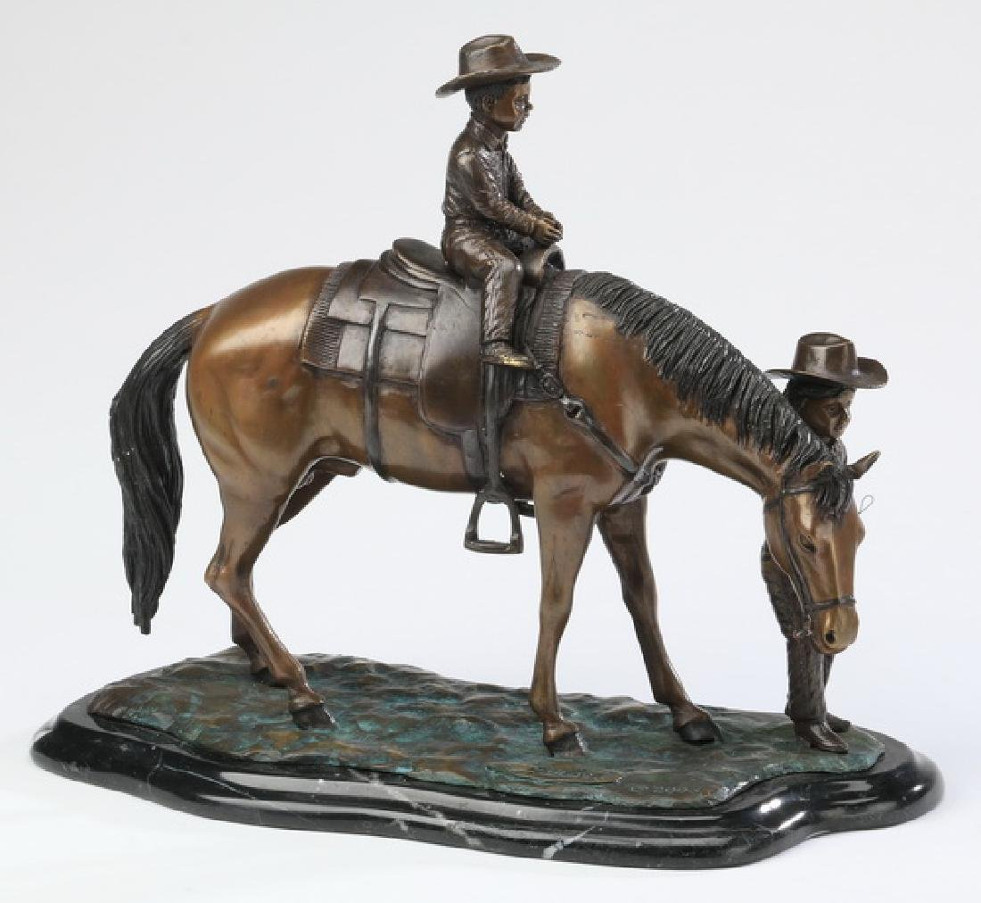 Bronze sculpture of two boys and their horse