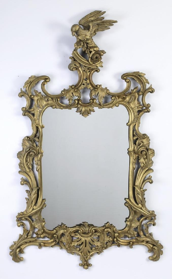 Elaborate carved gilt wood Rococo style mirror