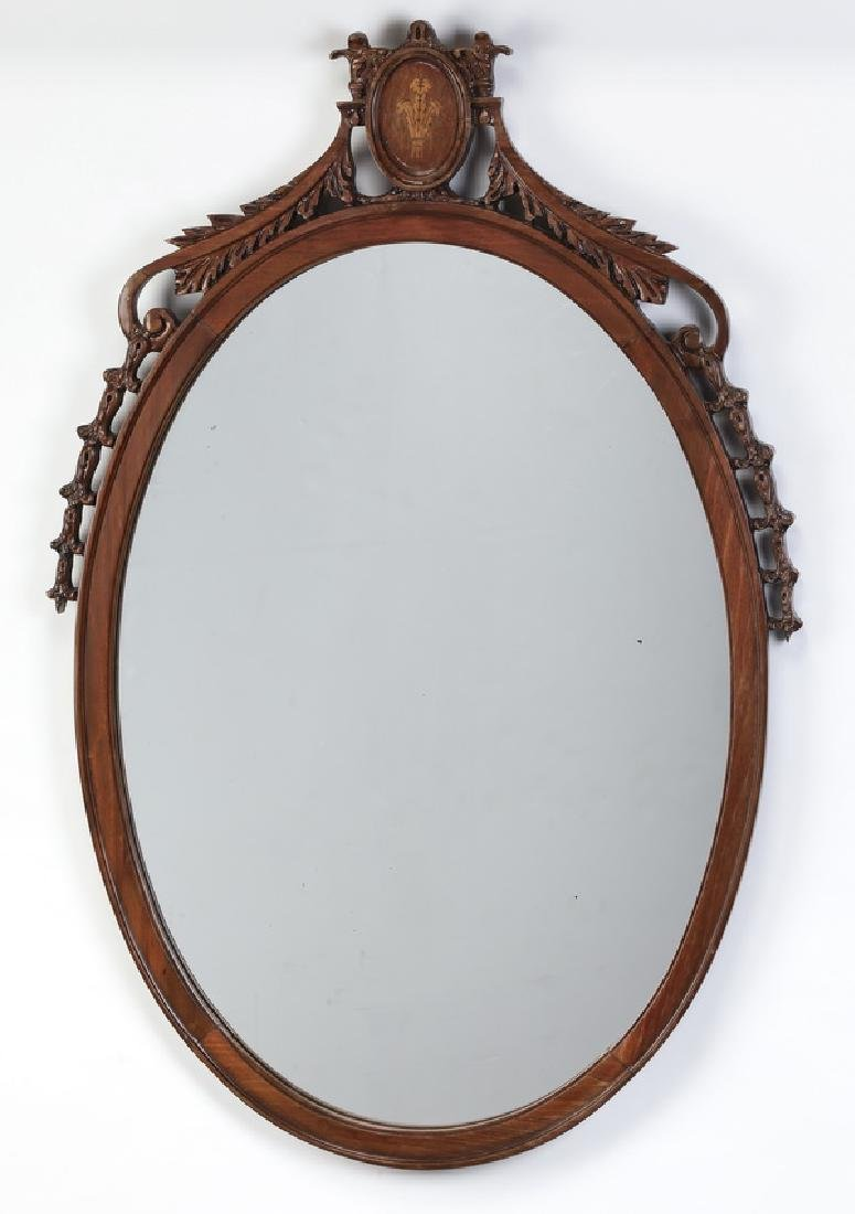Federal style oval mahogany mirror