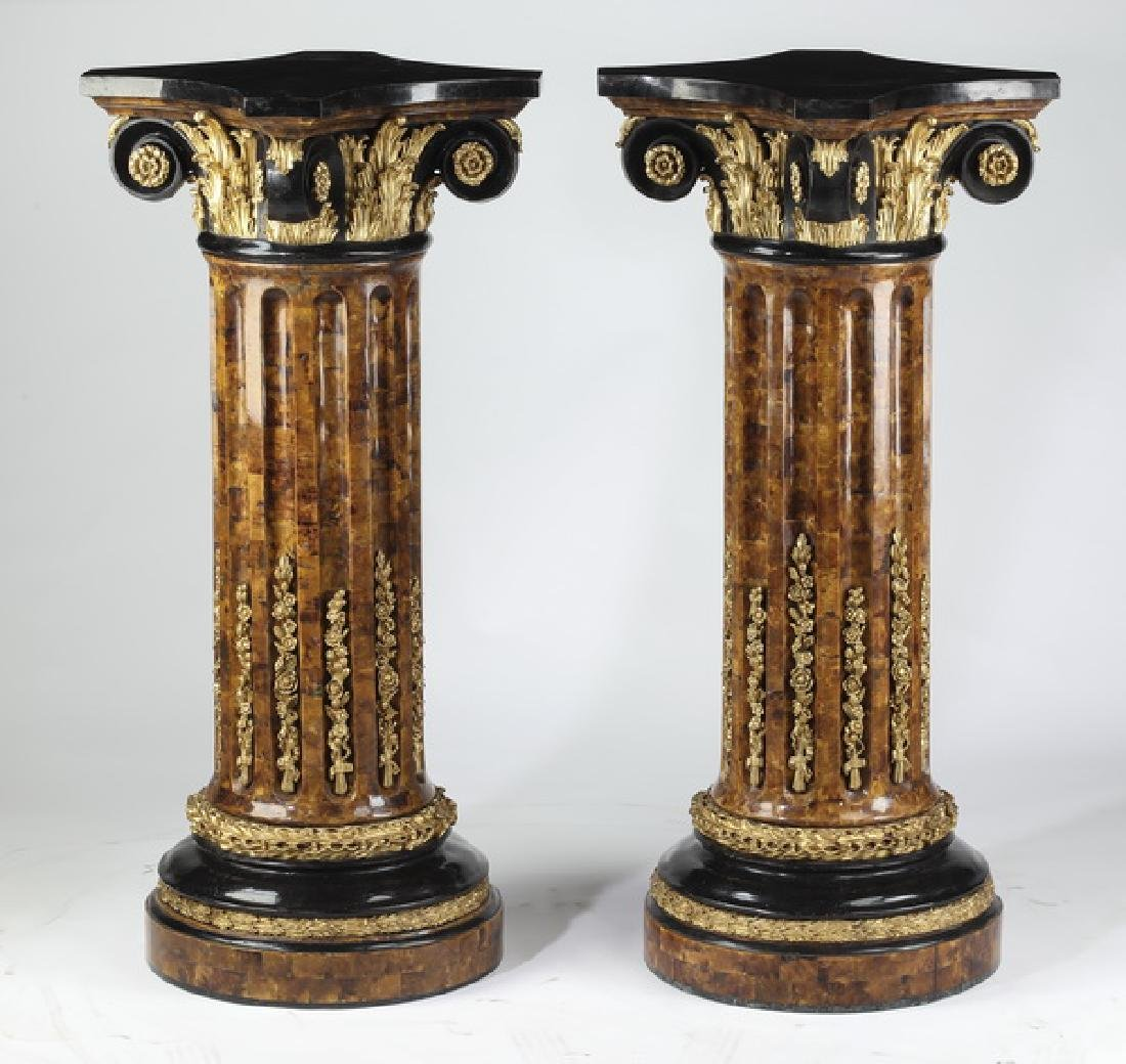 (2) Amber and black tessellated marble columns