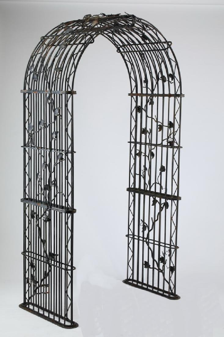 Wrought iron arched arbor, w/ climbing ivy