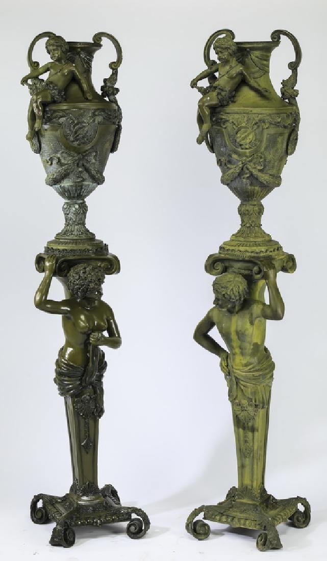 "(2) Figural bronze pedestals and urns, 76""h"