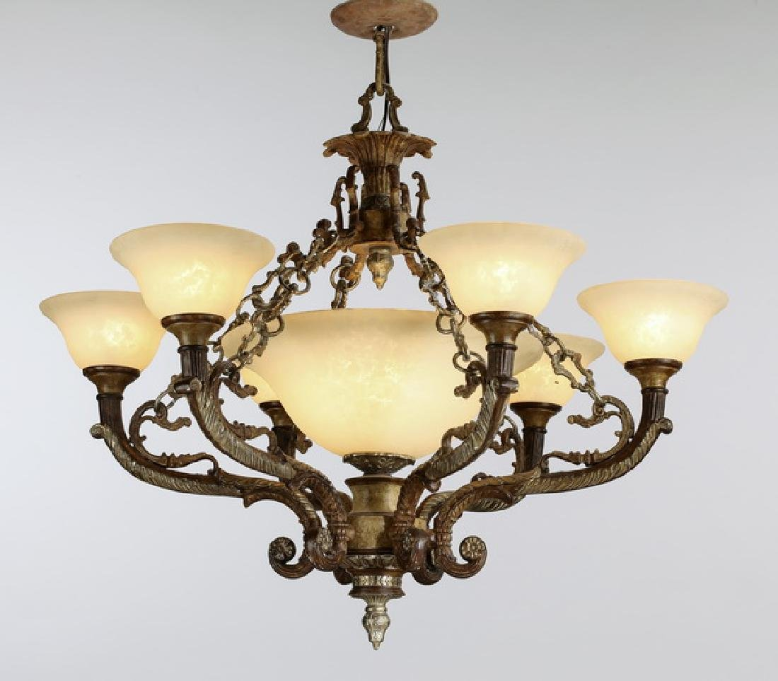 Patinated metal chandelier w/ glass shades