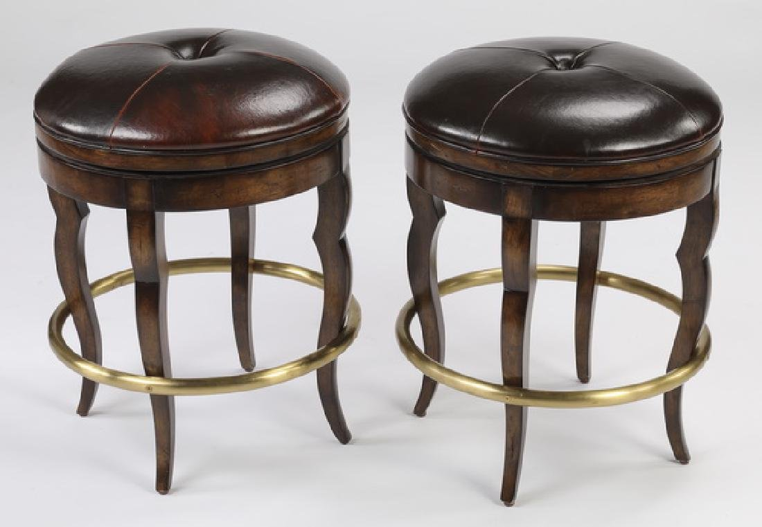 "(2) Swivel seat brown leather bar stools, each 23""h"