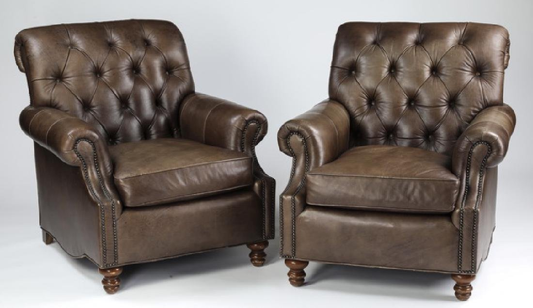 Pair of brown leather club chairs with nail head trim