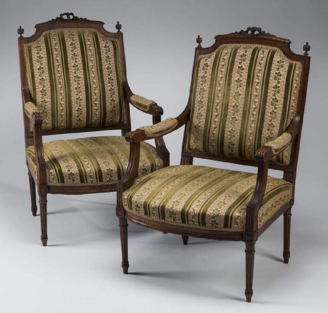 (2) 19th c. Louis XVI style carved walnut fauteuils