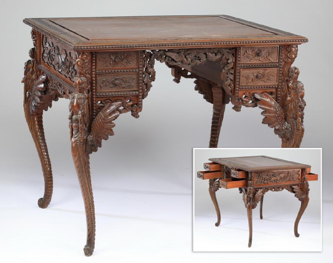 Chinoiserie carved partner's desk w/ dragon form legs