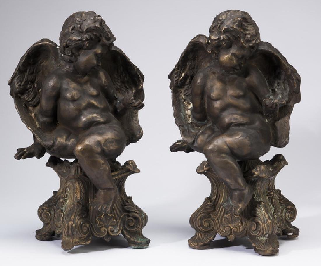 Pair of Rococo style bronze putto sculptures