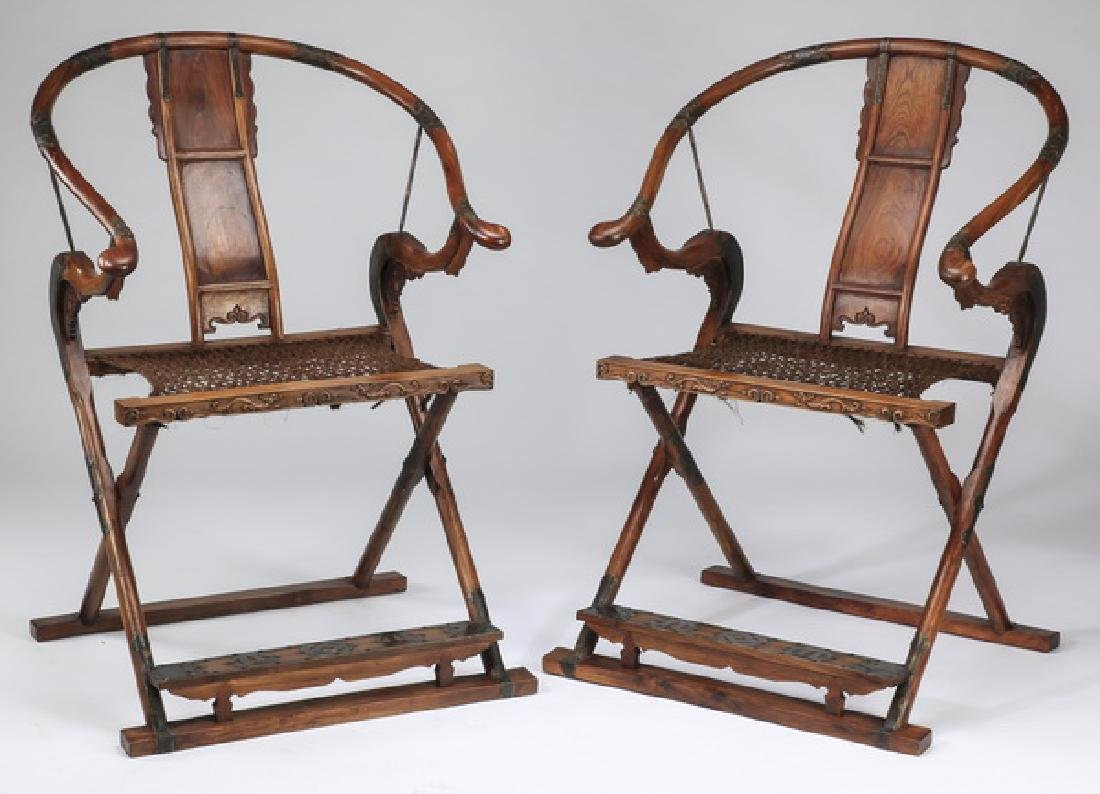 """(2) Chinese carved folding chairs w/ woven seats 42""""h"""