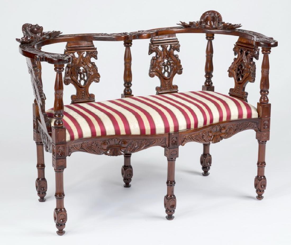 Edwardian style carved mahogany fantasy settee