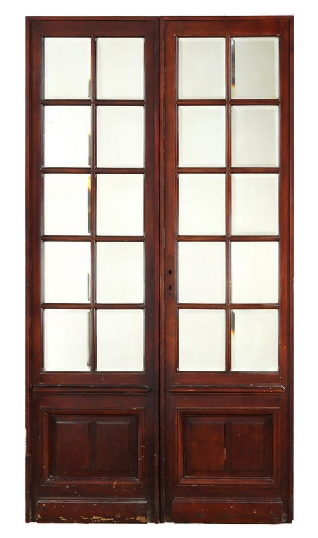 (2) Early 20th c. American mahogany mirrored doors