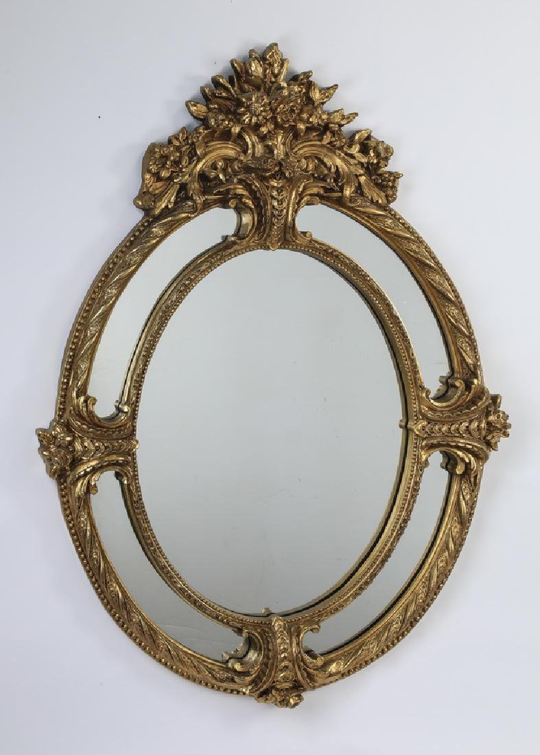 "Rococo style gilded oval mirror, 58""h"