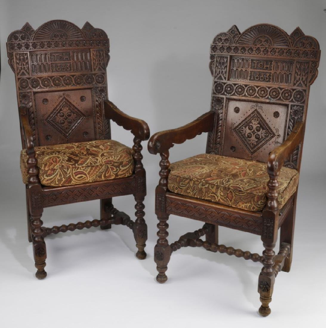 (2) 19th c. Jacobean Revival carved oak armchairs