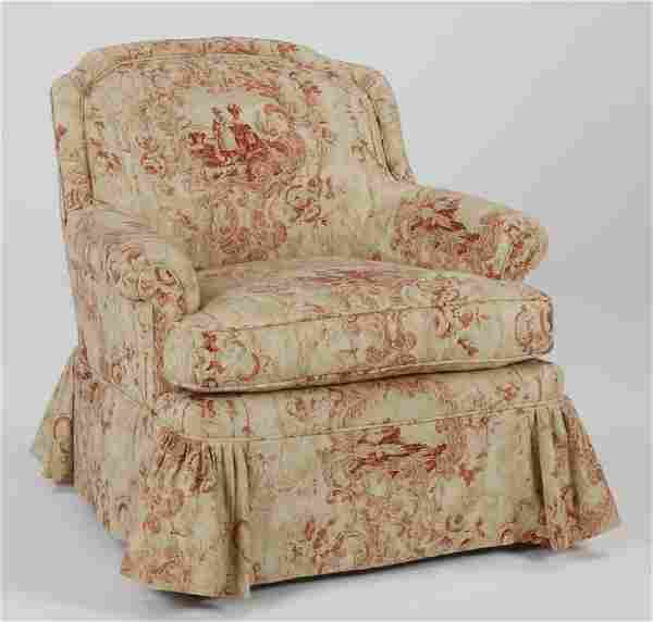 Custom made upholstered armchair in toile fabric