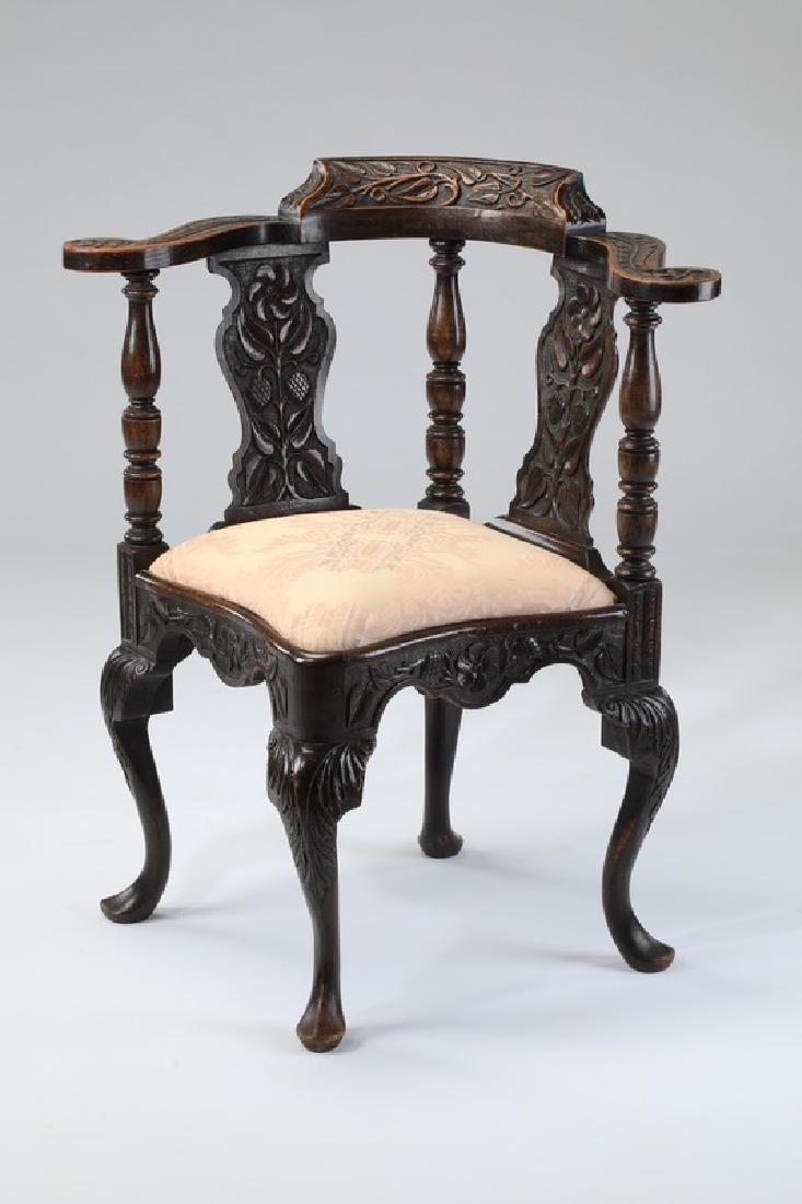 Early 20th c. carved walnut corner chair