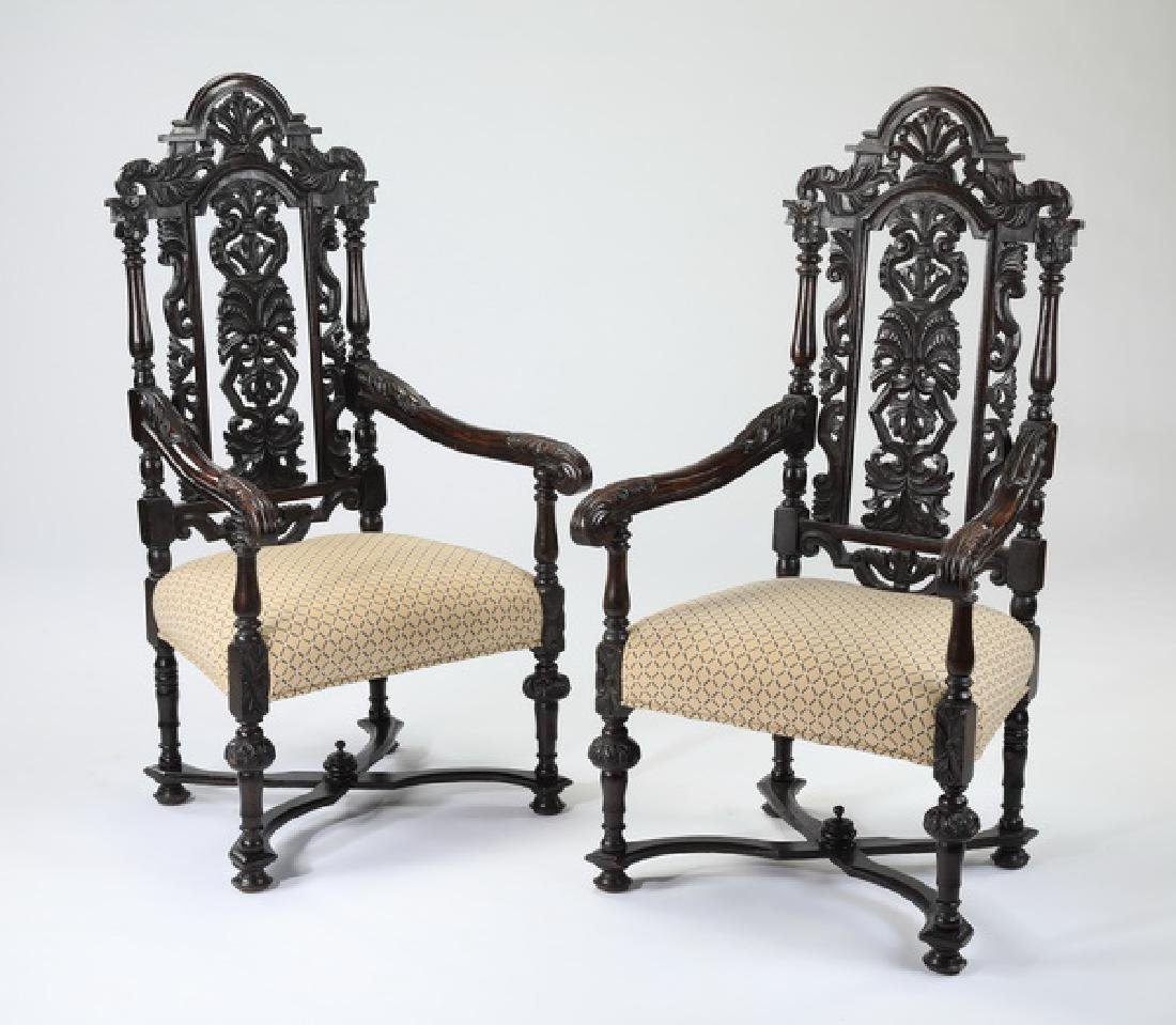 Jacobean style ebonized carved oak armchairs