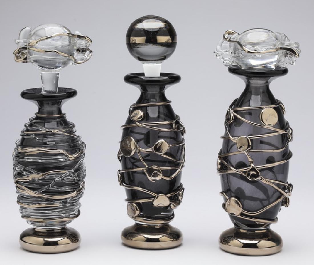 (3) Black art glass perfume bottles, signed