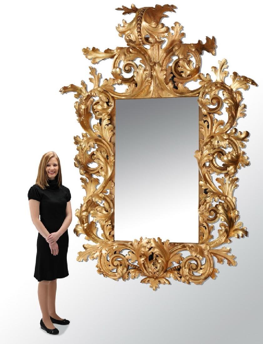 Monumental & extravagant 19th c. carved & gilt mirror