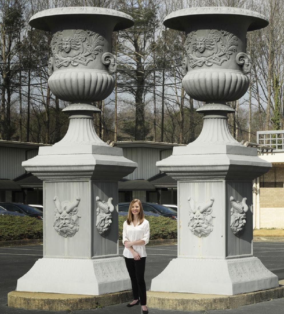 Monumental cast iron urns on pedestals, 12.5 ft tall
