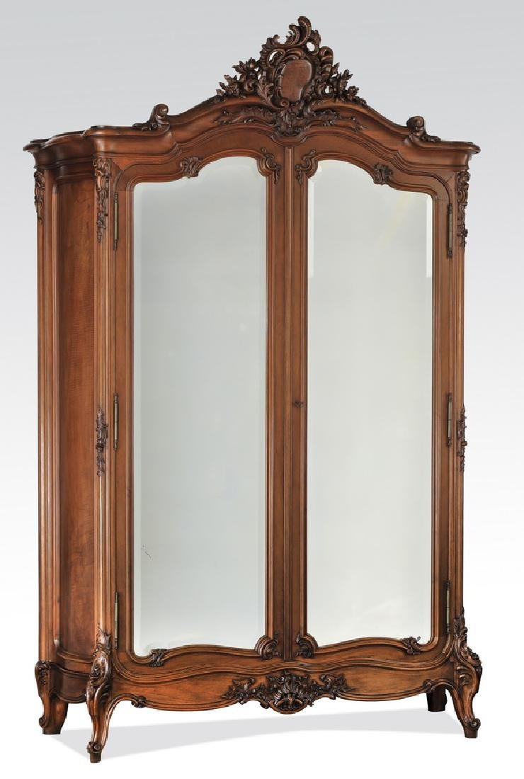 Monumental French walnut armoire w/ beveled mirrors