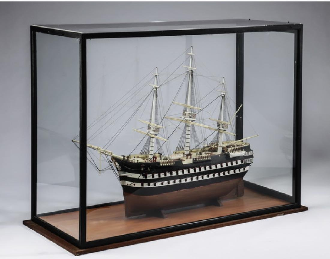 Model of three-masted ship, with custom display case