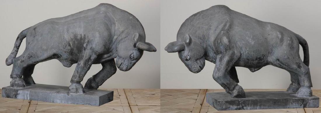 "Pair of carved black marble bulls, 47""w"