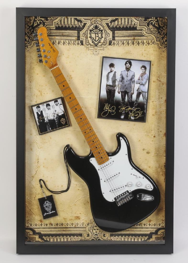 Signed Jonas Brothers photos w/ stratocaster, framed
