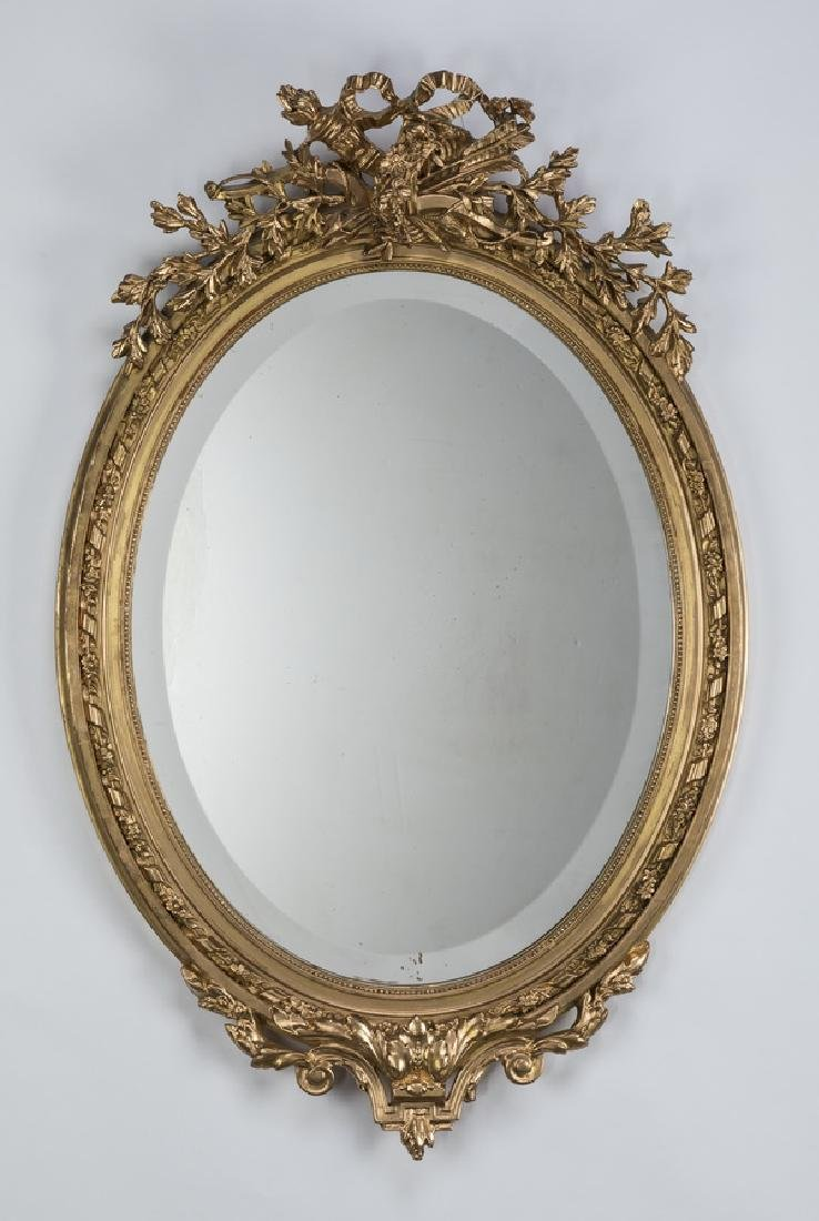 19th c. Rococo style oval gilt wood beveled mirror