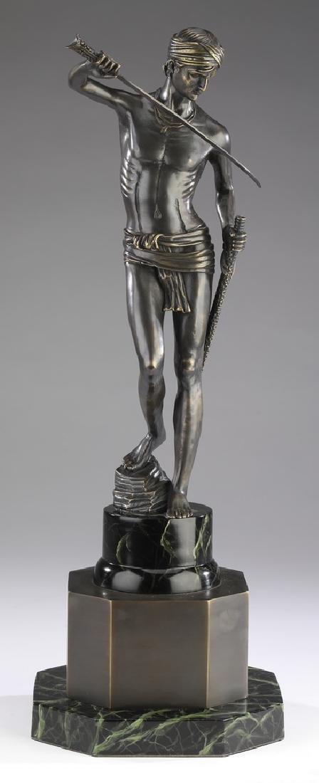 Orientalist style spelter sculpture of man with sword