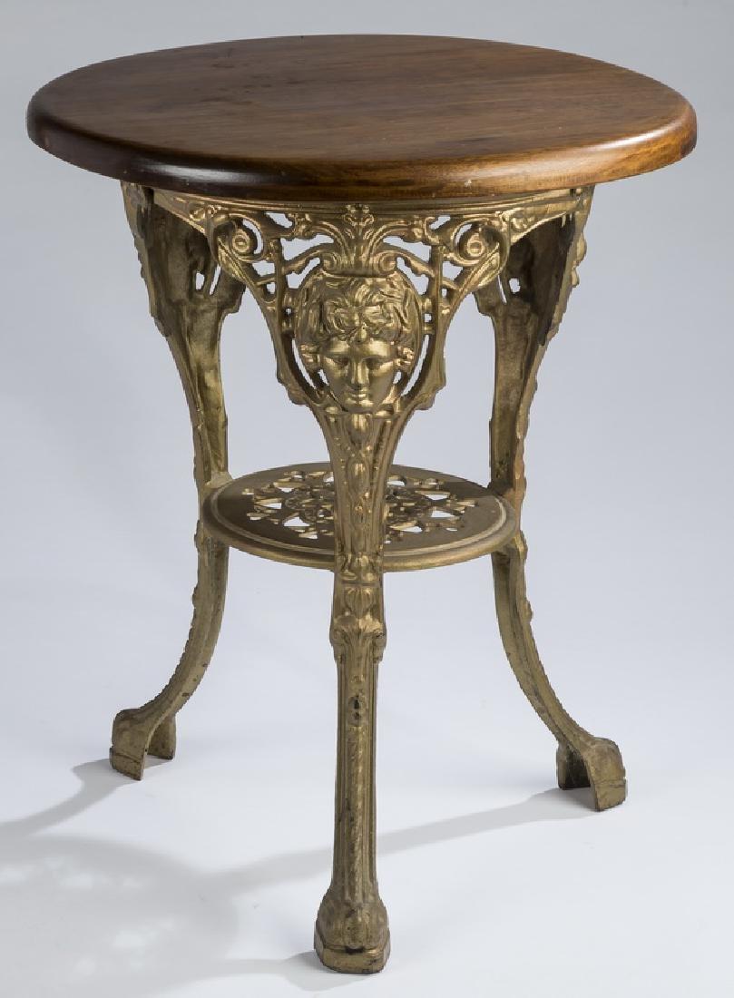 """Cast iron and mahogany table, 24"""" dia."""