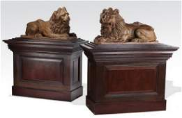 (2) Early 20th c.terracotta lions w/ wood bases