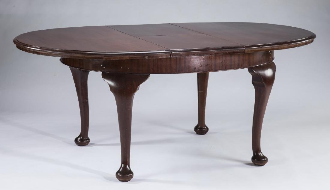 Queen Anne style oval mahogany dining table w/ leaf