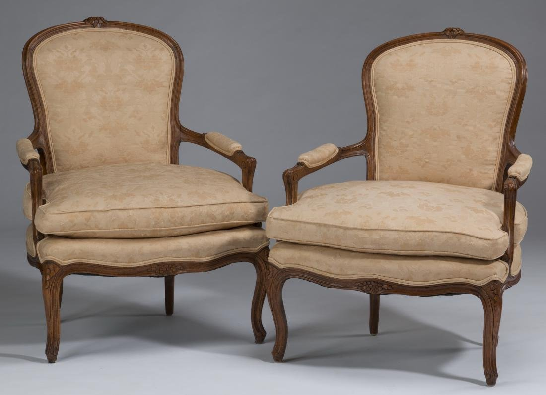 Pair of Louis XV style fauteuils w/ damask upholstery