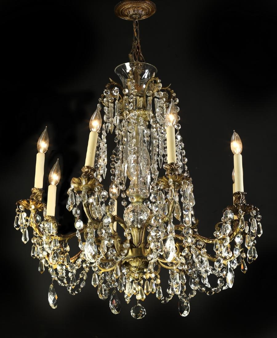 Early 20th c. brass and crystal 8-arm chandelier