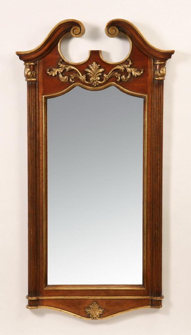 "Carved and parcel gilt mahogany mirror, 54""h"