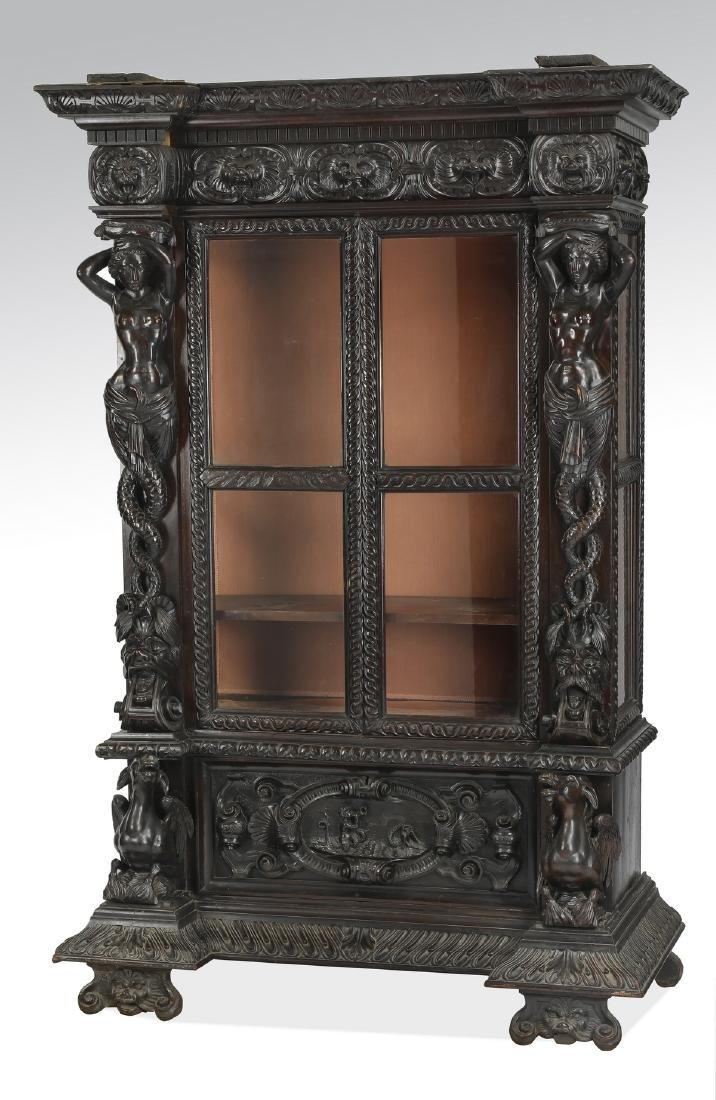 19th c. Italian carved and ebonized figural cabinet