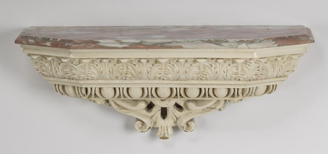 "Carved marble top paint-decorated wall bracket, 28""l"